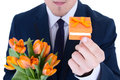 Man holding gift box with wedding ring and flowers isolated on w Royalty Free Stock Photos