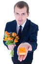 Man holding gift box with wedding ring isolated on white Royalty Free Stock Image