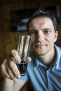 Man holding a glass of dark stout beer Royalty Free Stock Photo