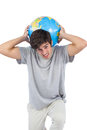 Man holding a globe on his back white background Royalty Free Stock Photo