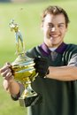 Man Holding Golf Trophy Royalty Free Stock Images