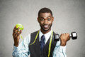 Man holding green apple dumbbell Royalty Free Stock Photo