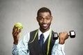 Man holding green apple dumbbell Royalty Free Stock Photo
