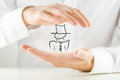 Man holding a hand drawn figure of businessman or performing artist wearing hat in his hands in conceptual image close up of Stock Image