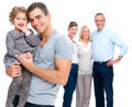 Man holding his daughter with family in background Royalty Free Stock Photography