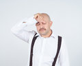 Man holding his head pain closed eyes in headache migraine Royalty Free Stock Images