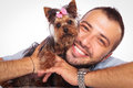 Man is holding his pet yorkshire terrier puppy dog Royalty Free Stock Photo