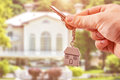 Man Holding keys on house shaped key Royalty Free Stock Photo