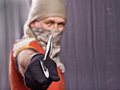 Man holding knife masked a on a black background focus forward Royalty Free Stock Photos