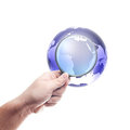 Man holding magnifying glass on globe Royalty Free Stock Photography