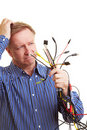 Man holding many different cables Stock Photos