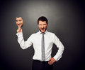 Man holding mask with smiley face wrathful businessman Stock Images