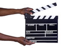 Man holding movie production clapper board isolated on white background Stock Photo