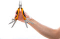Man holding a multifunction plier and knife set with an assortment of retractable blades can bottle openers file saw Royalty Free Stock Photos