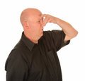 Man holding nose due bad smell Stock Images