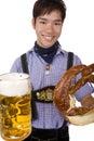 Man holding Oktoberfest beer stein and Pretzel Royalty Free Stock Photo