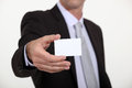 Man holding out business card a blank Royalty Free Stock Image
