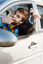 Man holding out car keys Royalty Free Stock Photo