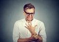 Man holding painful wrist arm. Sprain pain