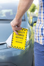 Man holding parking ticket holdig in his hand Royalty Free Stock Photo