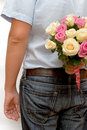 MAN HOLDING PINK AND CREAM ROSES Royalty Free Stock Photo