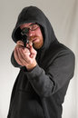 Man holding a pistol gun black dressed young Royalty Free Stock Photo