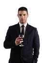 Man holding a red glass of fine wine view young isolated on white studio background Royalty Free Stock Image