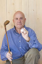Man holding retro golf stick and ball Royalty Free Stock Photography