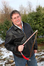 Man holding a saw on a Christmas tree farm Royalty Free Stock Photography