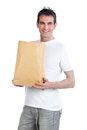 Man holding shopping paper bag young happy Royalty Free Stock Photo