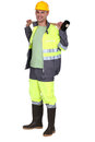 Man holding sledge hammer over shoulder Royalty Free Stock Images