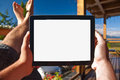 Man holding a tablet on balcony sunbathing point of view photo with empty screen Stock Images