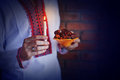 Man holding traditional ramadan food at night a candle and Stock Photo