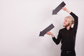 Man holding two arrows pointing same direction Royalty Free Stock Photo