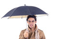Man holding umbrella in jacket with scarf wearing glasses Royalty Free Stock Photo