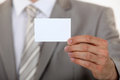 Man holding up business card Royalty Free Stock Photo
