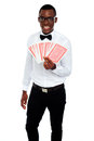 A man holding up a few playing cards Royalty Free Stock Photos