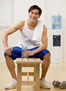 Man holding water bottle in health club Stock Image