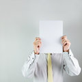 Man holding white board blank whiite on his face over background Royalty Free Stock Photos