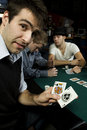 Man holding winning hand in poker Stock Images