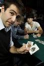 Man holding winning hand in poker Royalty Free Stock Photo