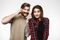 Man holding woman`s hair as it is moustache, smiling happily. Royalty Free Stock Photo