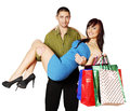 Man holding a woman women with paper bags Stock Photos
