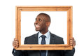 Man holding wooden picture frame Royalty Free Stock Photo