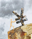Man holding the Yen from falling down a cliff Royalty Free Stock Photo