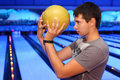Man holds ball and prepares to throw in bowling Stock Photography
