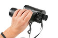 Man holds binoculars Royalty Free Stock Images