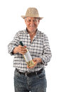 A man holds a bottle of wine farmer old in studio Royalty Free Stock Photos