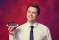 Man holds cake on red background Royalty Free Stock Photo