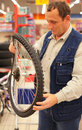 Man holds curved bicycle wheel Stock Photos